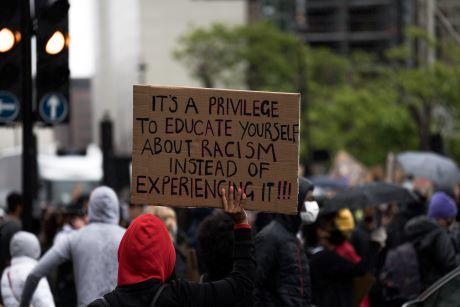 Racism protest sign